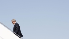 Prime Minister Stephen Harper boards his plane in Ottawa as he departs for a five-day, four-country visit to Europe, Tuesday, May 4, 2010. (Adrian Wyld / THE CANADIAN PRESS)