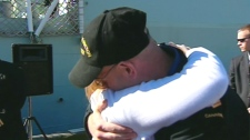 A couple embraces following the docking of HMCS Fredericton in Halifax, Tuesday, May 4, 2010.