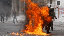 A riot police officer is engulfed in flames from a Molotov cocktail thrown by protestors in central Athens, Wednesday, May 5, 2010. (AP / Petros Giannakouris)
