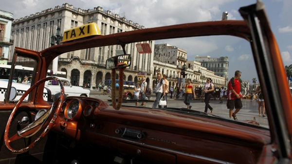 People make their way in front of the National Capitol building in Havana, Tuesday, May 4, 2010. (AP Photo/Javier Galeano)