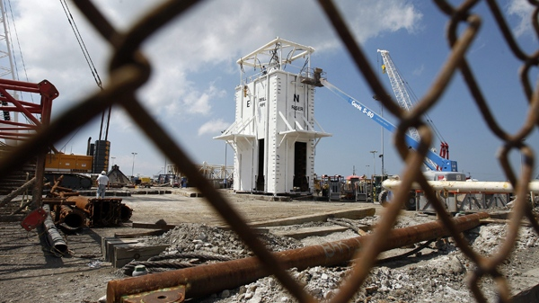 Workers at the Wild Well Control company work on a chamber that will be used to help contain oil leaking from the Deepwater Horizon oil drilling platform in Port Fourchon, La., Wednesday, May 5, 2010. (AP / Patrick Semansky)