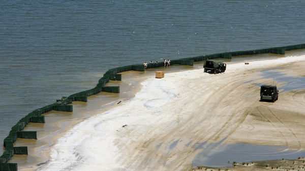 Members of the U.S. Army National Guard install Hesco containers along the beaches of Dauphin Island, Ala., Tuesday May 4, 2010. (Press-Register / John David Mercer)