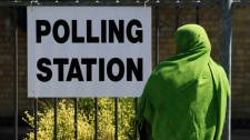 A voter arrives at a polling station in east London, housed in a local school, during Britain's general election on Thursday, May 6, 2010. (AP / Lefteris Pitarakis)