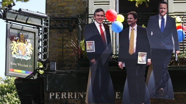 Effigies of party leaders Gordon Brown, Nick Clegg and David Cameron are displayed on the balcony of a pub, on a balcony as the country goes to the polls to elect a new Parliament and leader in London, Thursday, May 6, 2010. (AP / Alastair Grant)