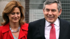 British Prime Minister Gordon Brown, right, and his wife Sarah, left, are seen after they have cast their vote's in Britain's General Election in North Queensferry, Fife, Scotland, Thursday, May 6 2010. (AP / Scott Heppell)