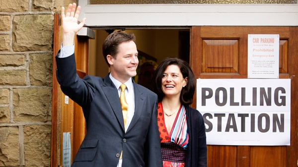 Britain's Liberal Democrat Party leader Nick Clegg stands alongside his wife Miriam Gonzalez Durantez as he waves to supporters and members of the media after voting in his Sheffield constituency during Britain's general election in Sheffield, England, Thursday, May 6, 2010. (AP / Jon Super)