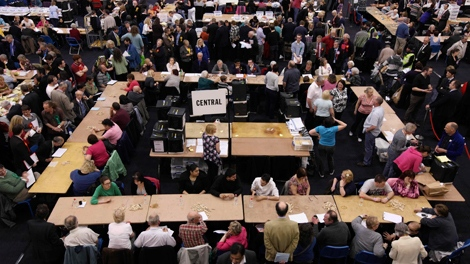 Volunteers count votes at Ponds Forge sports centre in Sheffield, England, during Britain's general election, Thursday May 6, 2010. (AP / Jon Super)
