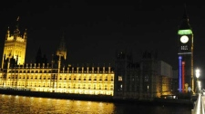 Election exit poll results are projected onto the Clock Tower of the Palace of Westminster, London, Thursday May 6, 2010. (AP / Tom Hevezi)