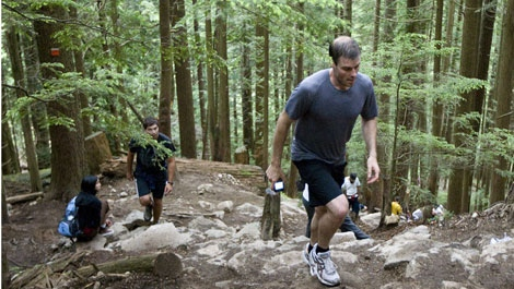 Sebastian Albrecht climbs a steep section of the Grouse Grind hiking trail in North Vancouver, B.C. Monday, June 22, 2009.  THE CANADIAN PRESS/Jonathan Hayward