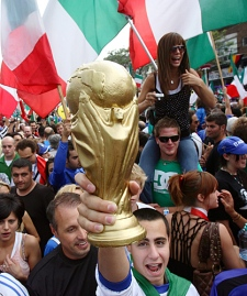 Thousands of soccer fans jammed the streets of Toronto's little Italy to celebrate following Italy's win in the World Cup soccer final on Sunday, July 9, 2006. (CP PHOTO/Frank Gunn)