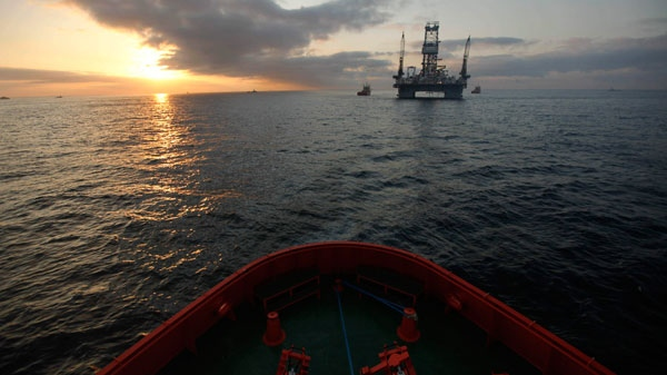 The Development Driller III, which is drilling a relief well, is seen at sunrise from the Joe Griffin supply boat at the site of the Deepwater Horizon oil spill containment efforts in the Gulf of Mexico off the coast of Louisiana, Saturday, May 8, 2010. (AP / Gerald Herbert)