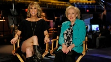 "In this publicity image released by NBC, cast member Kristen Wiig, left, and Betty White are shown on the set of ""Saturday Night Live"" in New York, on Tuesday, May 4, 2010. (NBC / Dana Edelson)"