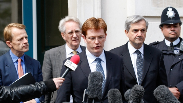 Britain's Liberal Democrats party negotiation team Chief of Staff, Danny Alexander, third left, Home Affairs spokesman, Chris Huhne, second right, campaign vice-chairman, Andrew Stunell, second left, and school spokesman, David Laws, left, speak to the media as they leave the Cabinet Office in London following negotiations with the Conservative party to form a coalition government, Monday, May 10, 2010. (AP / Sang Tan)