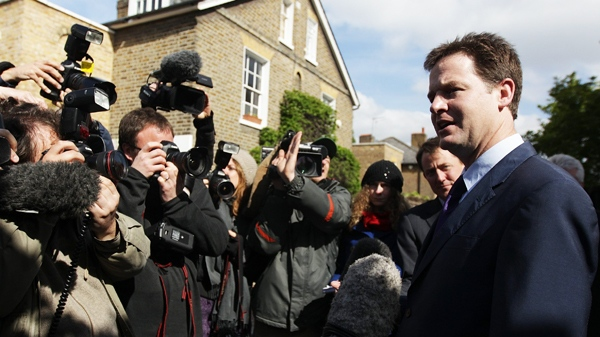 Britain's Liberal Democrats party leader Nick Clegg, right, speaks to the media as he leaves his house in London on Monday, May 10, 2010. (AP / Simon Dawson)