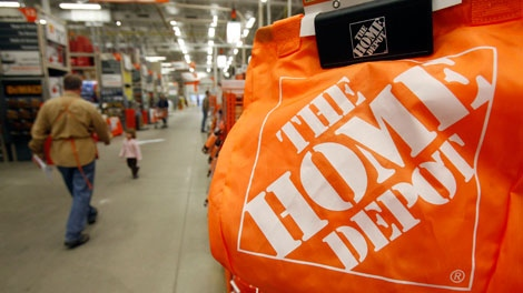 Shoppers walk through the aisles at the Home Depot store in Williston, Vt., Monday, Feb. 22, 2010. (AP Photo/Toby Talbot)