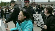 Demonstrators are seen near the OSPCA shelter in Newmarket, Ont., on Wednesday, May 12, 2010.