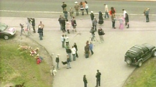 A crowd of protesters gather outside an SPCA shelter in Newmarket where more than 300 animals are being euthanized after a ringworm outbreak.