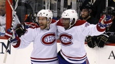 Montreal Canadiens' Dominic Moore, left, celebrates his first-period goal with P.K. Subban against the Pittsburgh Penguins in the first period of Game 7 of the NHL hockey Eastern Conference semifinals Wednesday, May 12, 2010, in Pittsburgh. (AP Photo / Gene J. Puskar)