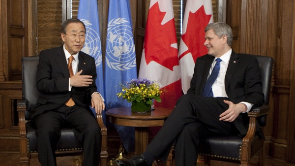 United Nations Secretary-General Ban Ki-Moon speaks with Prime Minister Stephen Harper at the start of a meeting on Parliament Hill in Ottawa, Wednesday May 12, 2010. (Adrian Wyld / THE CANADIAN PRESS)