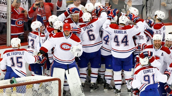 The Montreal Canadiens celebrate after defeating the Pittsburgh Penguins 5-2 in Game 7 of the NHL hockey Eastern Conference semifinals, in Pittsburgh on Wednesday, May 12, 2010. (AP / Keith Srakocic)