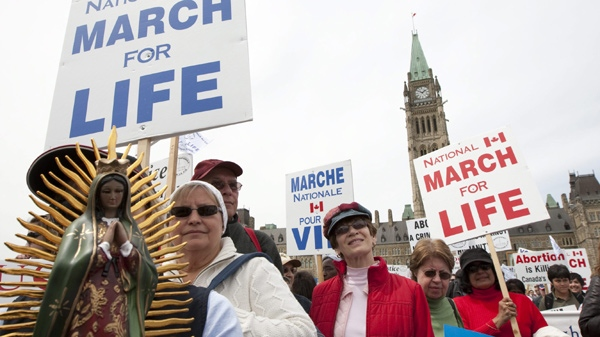 Anti-abortion activists march off of Parliament Hill in Ottawa on Thursday May 13, 2010. (Sean Kilpatrick / THE CANADIAN PRESS)