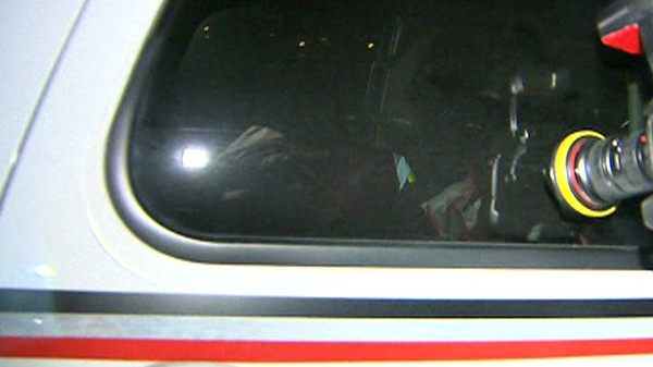 The unidentified driver covers his face as he is transported in a TTC vehicle from Toronto police Traffic Services headquarters, Wednesday night, May 13, 2010.