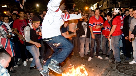 Montreal Canadiens fans celebrate in Montreal following the Montreal Canadiens defeat over the Pittsburgh Penguins in their game 7 NHL hockey Eastern Conference semifinal series,  Wednesday, May 12, 2010. (Graham Hughes / THE CANADIAN PRESS)
