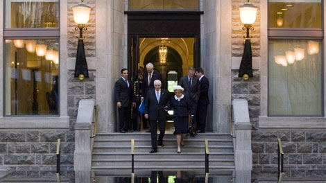 Paul Desmarais, front left, and his wife, Jacqueline Desmarais, are followed by their sons Andre Desmarais and Paul Desmarais Jr.as they head to the Power Corp. annual meeting Thursday, May 13, 2010 in Montreal. (THE CANADIAN PRESS/Ryan Remiorz)