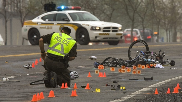 Police examine the scene where a pickup truck plowed into a group of cyclists in Rougemont, Que., Friday, May 14, 2010. (Ryan Remiorz / THE CANADIAN PRESS)