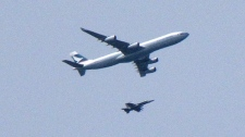 A CF18 Hornet fighter jet, acting under the North American Aerospace Defence Command, intercept a Cathay Pacific passenger plane headed for Vancouver on Saturday May 15, 2010. (Patrick Beaton / THE CANADIAN PRESS)