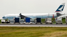 A Cathay Pacific passenger plane sits on the tarmac at the Vancouver International Airport on Saturday May 15, 2010. (Don MacKinnon / THE CANADIAN PRESS)