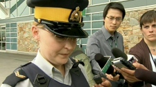 Cpl. Sherrdean Turley from the Richmond RCMP unit speaks to media about the bomb threat, Saturday, May 15, 2010.