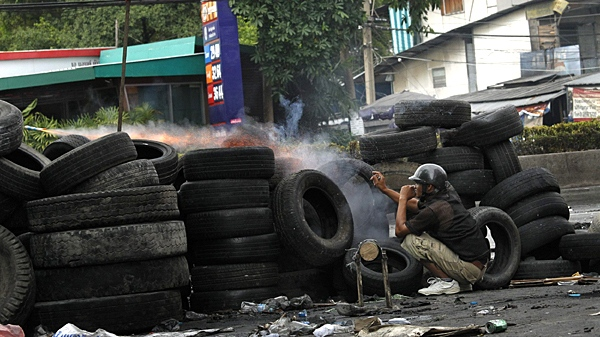 An anti-government protester fire home-made rockets towards Thai soldier in Bangkok, Thailand, on Sunday, May 16, 2010. (AP / Vincent Yu)
