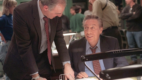 Actor Jerry Orbach, right, and his double, Ed Murphy, talk on the set of 'Law & Order' in New York on Feb. 16, 1999. (AP / Lynsey Addario)