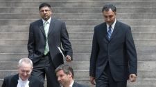 Former ministerial aides Bobbi Virk, left, and Dave Basi are seen leaving the B.C. Supreme Court in downtown Vancouver, Monday, May 17, 2010. THE CANADIAN PRESS/Jonathan Hayward