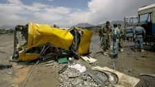 The mangled remains of a vehicle lies at the location of a suicide attack in Kabul, Afghanistan, Tuesday, May 18, 2010. (AP / Ahmad Massoud)