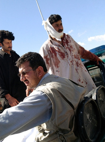 Injured people are taken away in a police vehicle after a suicide attack in Kabul, Afghanistan, Tuesday, May 18, 2010. (AP / Amir Shah)