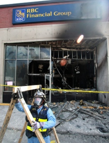 A fire marshal sets up equipment in front of a Royal Bank branch in Ottawa on Wednesday, May 19, 2010. (Patrick Doyle / THE CANADIAN PRESS)