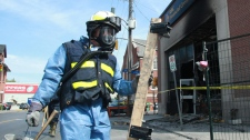 A fire marshal carries equipment to a Royal Bank branch in Ottawa on Wednesday, May 19, 2010. (Patrick Doyle / THE CANADIAN PRESS)