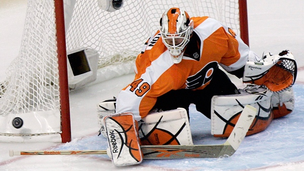 Philadelphia Flyers goalie Michael Leighton deflects a shot during the second period of Game 2 of the NHL hockey Eastern Conference finals with the Montreal Canadiens, Tuesday, May 18, 2010, in Philadelphia. (AP Photo/Tom Mihalek)