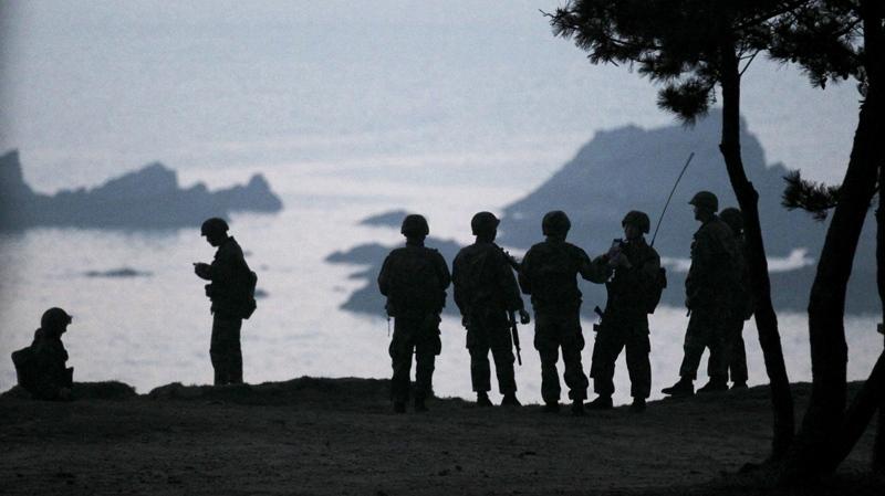 South Korean Marines stand guard on Baengnyeong Island, South Korea, near the border with North Korea, Thursday, May 20, 2010. (Yonhap / Kim Ju-sung)