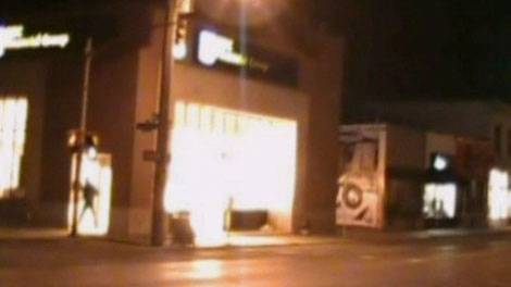 A suspect is seen running from a Royal Bank of Canada branch in Ottawa's Glebe neighbourhood in a video posted online, Tuesday, May 18, 2010.