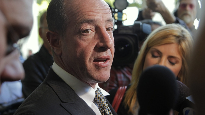 Michael Lohan, father of actress Lindsay Lohan, takes questions about his daughter, after a hearing on Thursday, May 20, 2010, in Beverly Hills, Calif. (AP / Damian Dovarganes)