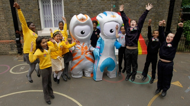 The Olympic mascot Wenlock, left, and the Paralympic mascot Mandeville strike an Usain Bolt pose with school children, as they are unveiled to the media as the mascots for London 2012, at a school in London, Wednesday, May 19, 2010. (AP / Matt Dunham)