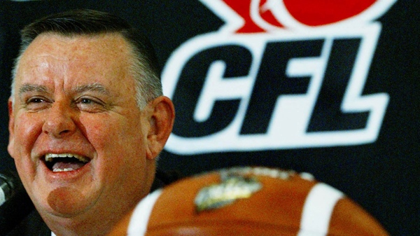 Canadian Football League interim commissioner David Braley laughs at a question during a news conference in Edmonton, November 22, 2002. (THE CANADIAN PRESS / Kevin Frayer)