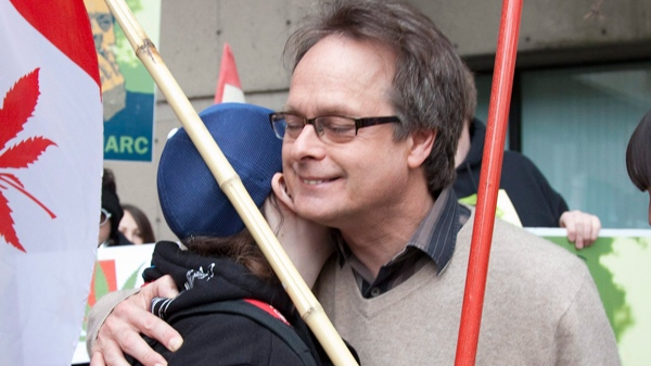 """Marc Emery, the self-describe """"Prince of Pot"""", right, receives a hug from a supporter outside the B.C. Supreme Court in Vancouver, Monday, May 10, 2010. ( THE CANADIAN PRESS/ Jonathan Hayward)"""