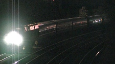 A passenger train is seen near Dunn Avenue and the Gardiner Expressway in Toronto during the early morning hours of Saturday, May 22, 2010. Earlier, the train was involved in two fatal incidents.
