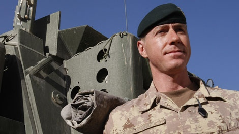 Brig. Gen. Daniel Menard, commander of Canada's Task Force Afghanistan, stands by a Light Armored Vehicle (LAV) in Kandahar Province, southern Afghanistan, Saturday, Jan. 30, 2010. (AP Photo/Kirsty Wigglesworth)