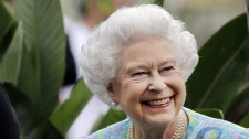 Britain's Queen Elizabeth II smiles as she talks to an exhibitor as she visits a garden at the Chelsea Flower Show in London, Monday, May 24, 2010. The show, which has 600 exhibitors, opens to the public on Tuesday. (AP Photo/Matt Dunham, Pool)