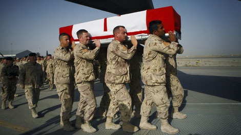 Comrades of fallen Canadian trooper Larry Rudd carry his casket onto a plane during a ramp ceremony at Kandahar Airfield, in Afghanistan, Wednesday, May 26, 2010. (AP Photo/Anja Niedringhaus)